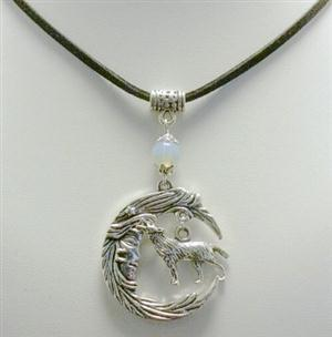 New and very pretty Wolf necklace that has a suede cord.