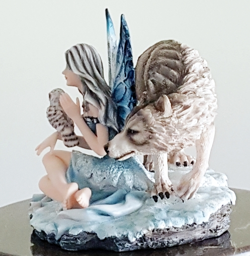 snow-fairy-with-wolf-owl-figurine-2.jpg