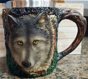 There is a handsome Wolf face on this mug.