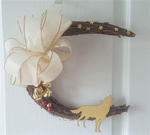 We love the large gold jingle bells on this Wolf Wreath.