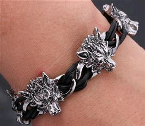This is a leather and stainless steel Wolf bracelet.