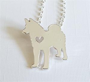 A new necklace with a cute Wolf design.